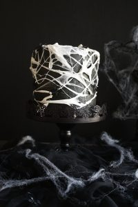 marshmallow spiderweb cake on cake stand