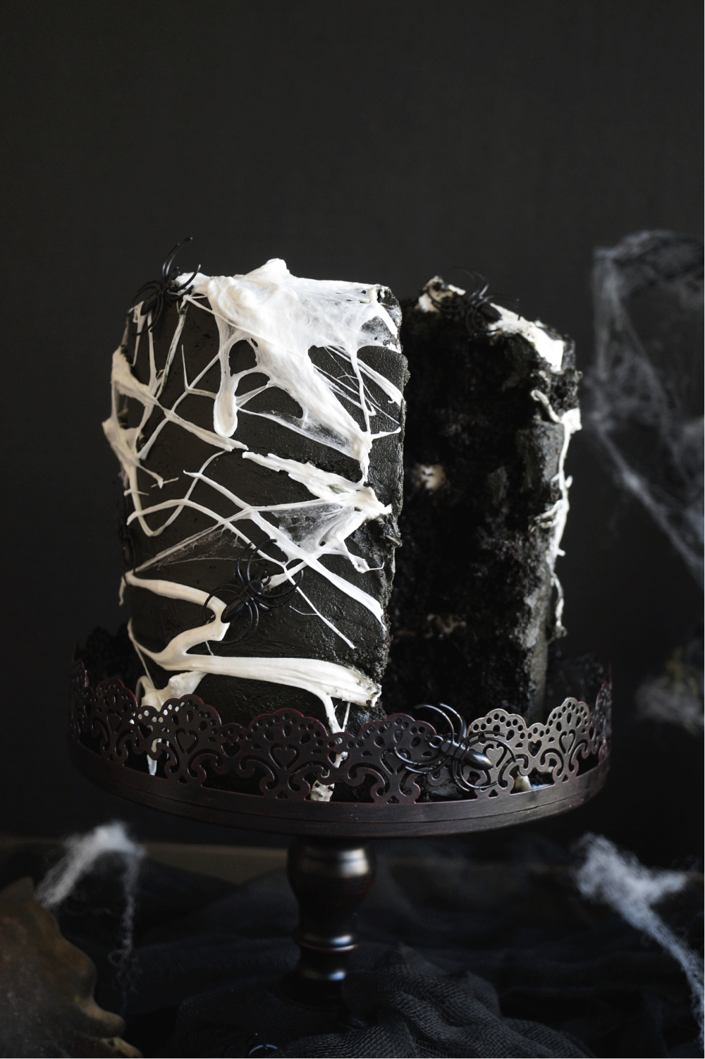 spiderweb cake with slice cut