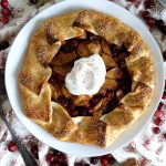 overhead shot of apple galette with whipped cream