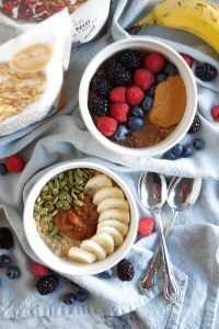 overhead shot of two decorated bowls of oatmeal