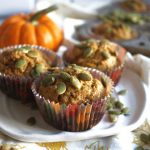 muffins on a plate with pumpkin seeds