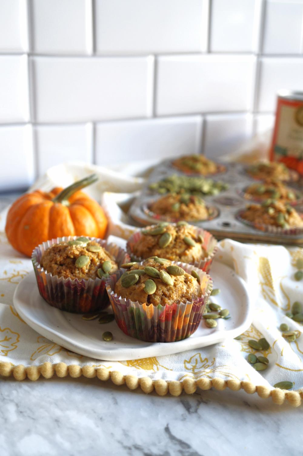 pumpkin banana muffins on pumpkin shaped plate