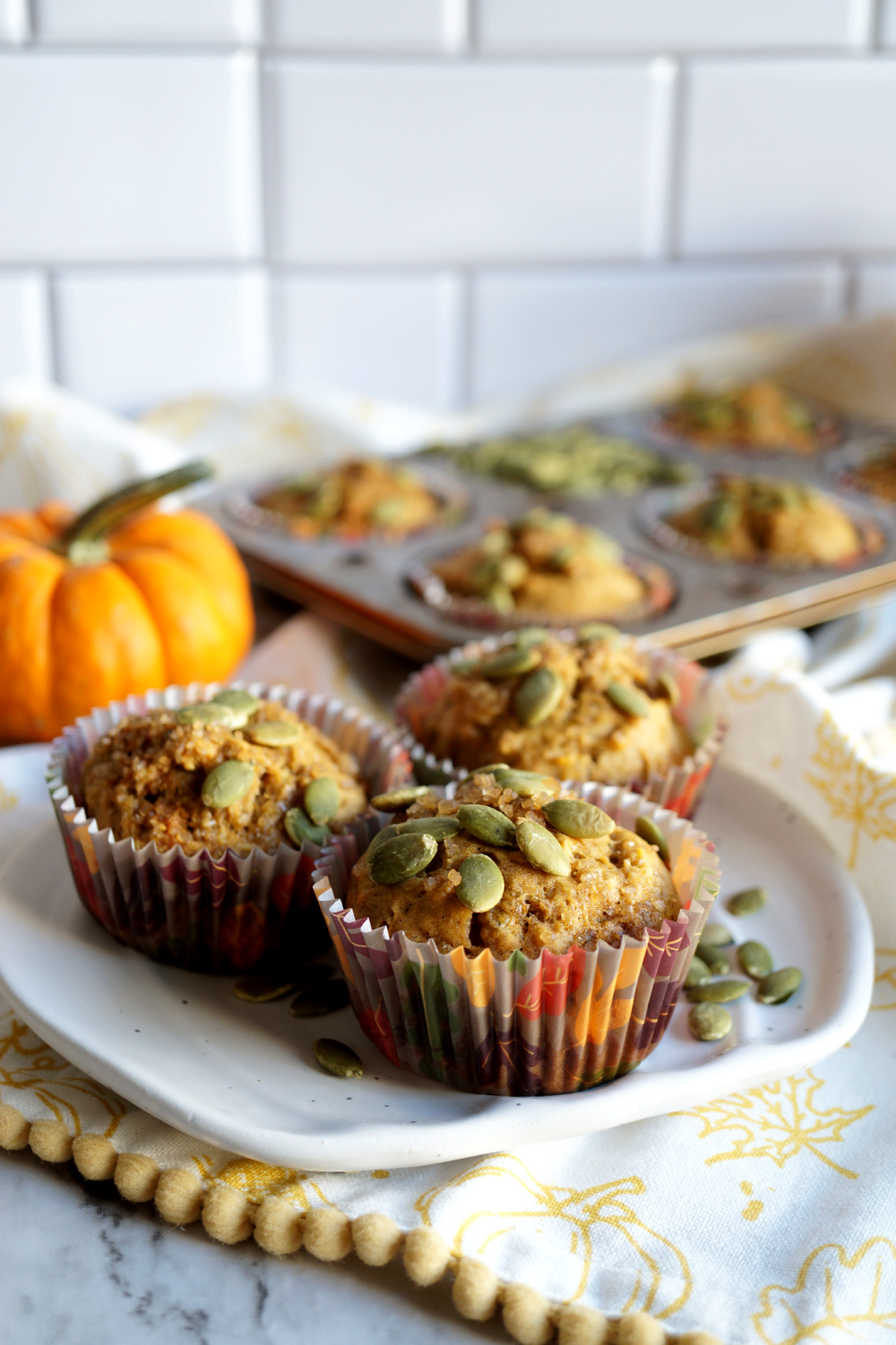 trio of pumpkin banana muffins on a plate