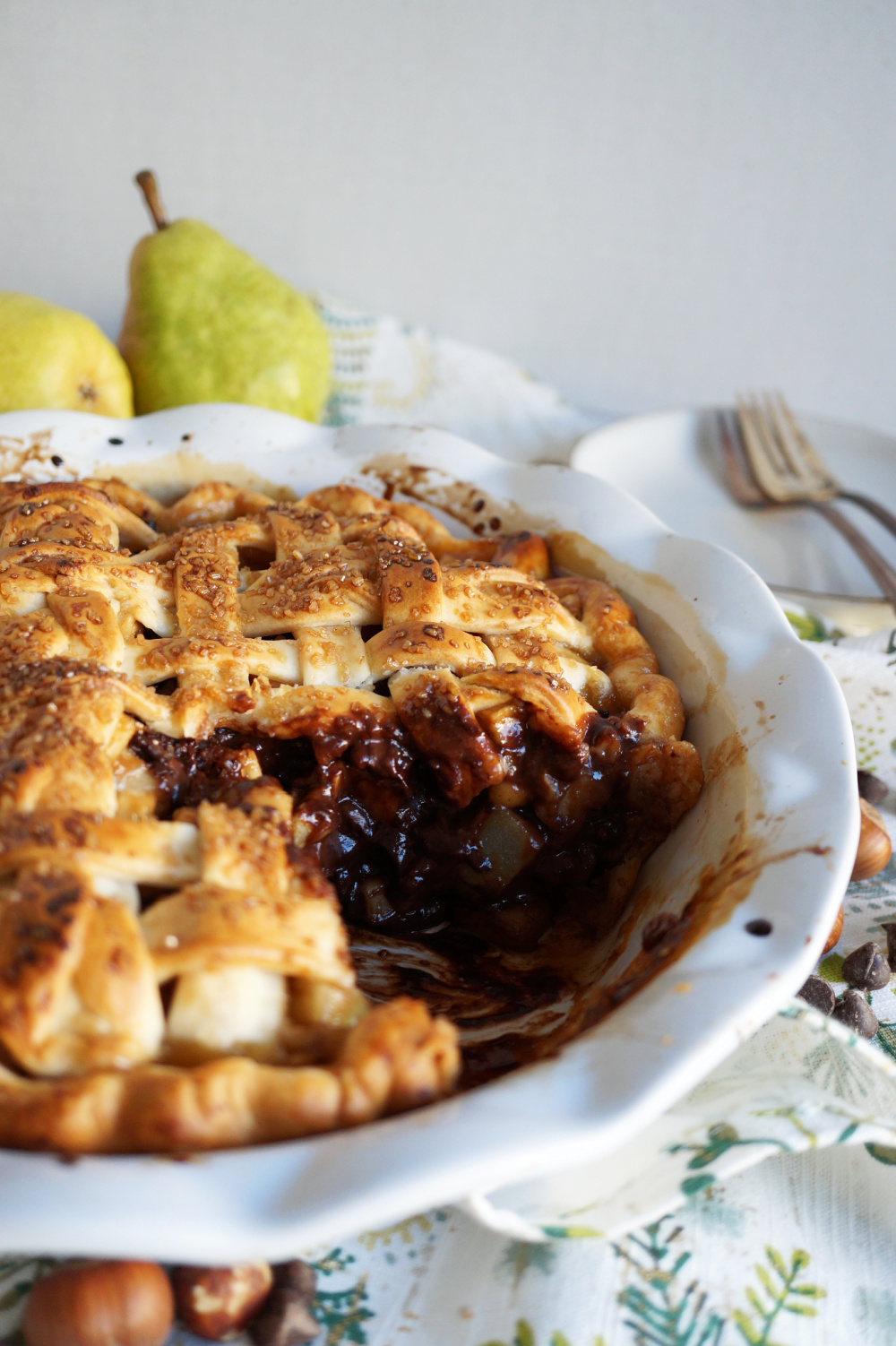 sliced hazelnut pear pie in plate