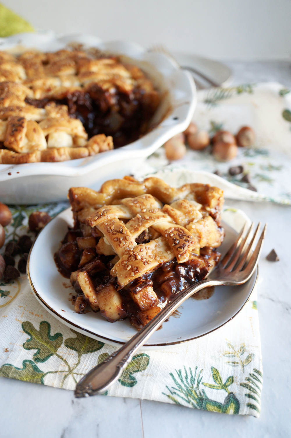 slice of chocolate hazelnut pear pie on a plate