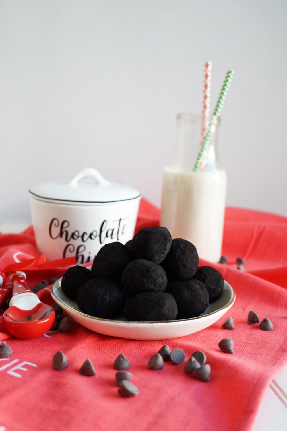 black chocolate truffles on plate