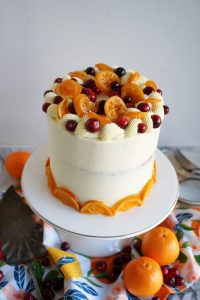 angled shot of top of cranberry clementine cake with candied citrus slices