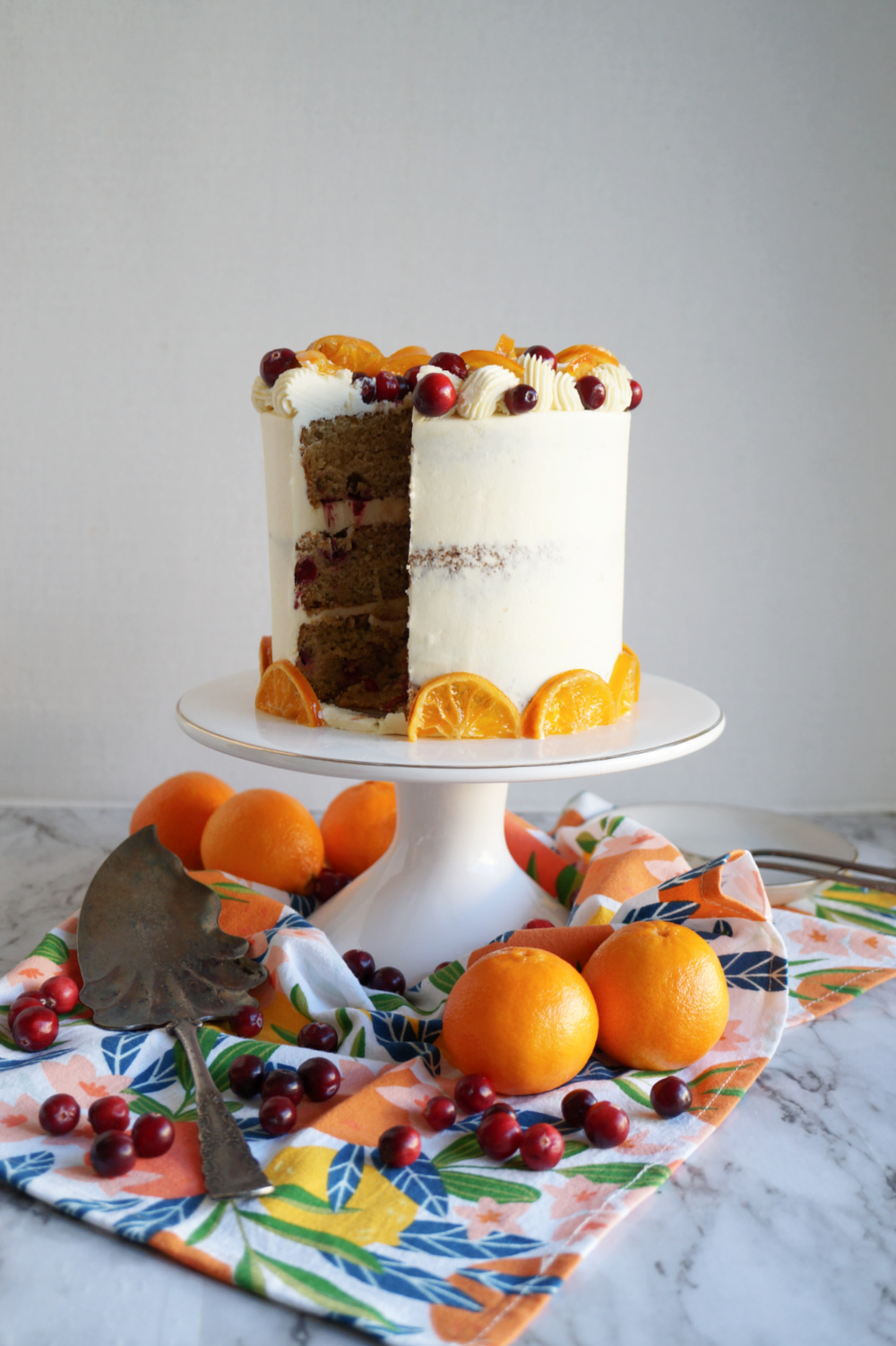 cranberry clementine cake with slice cut out