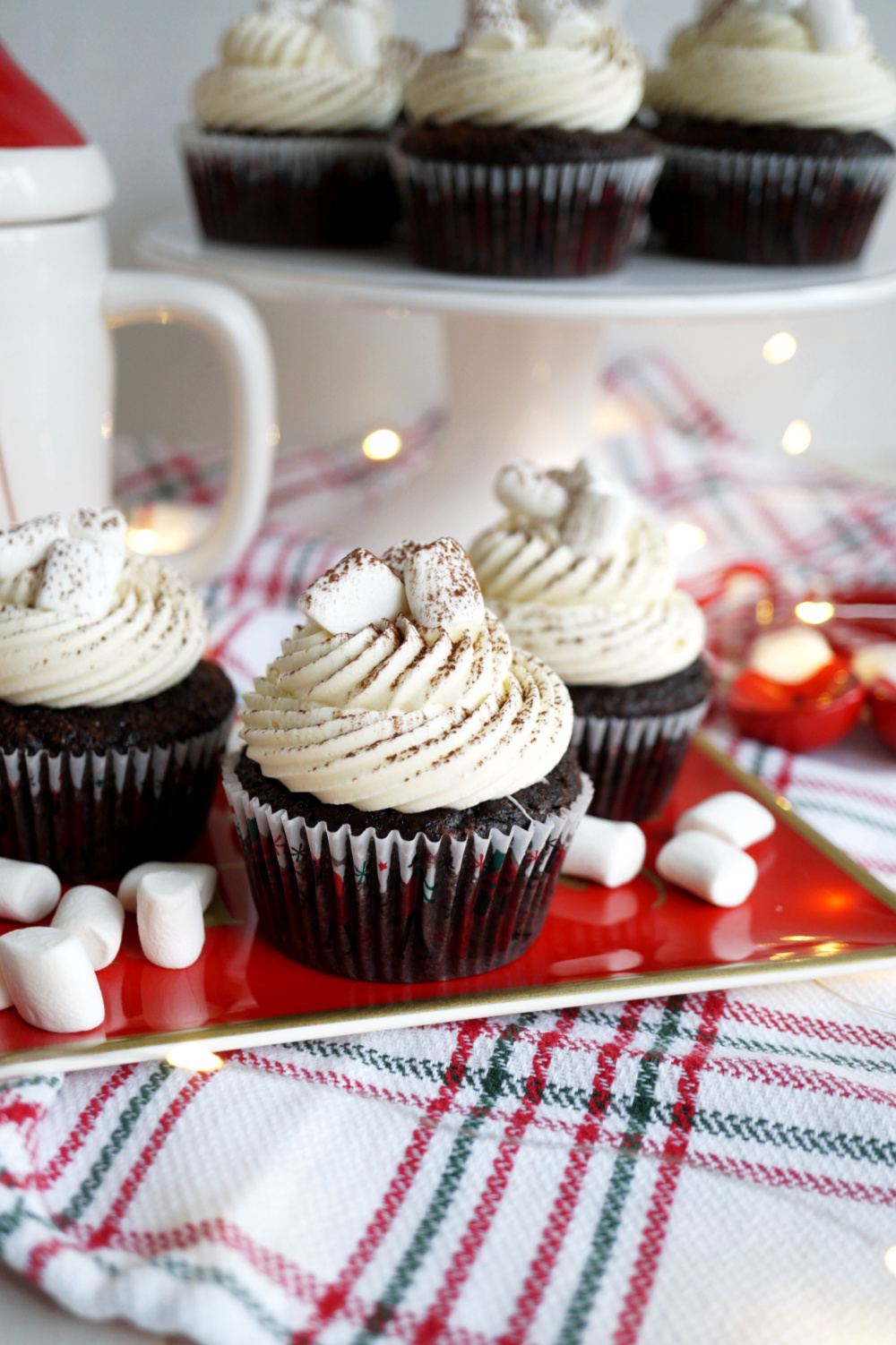 chocolate cupcakes with marshmallows on red tray