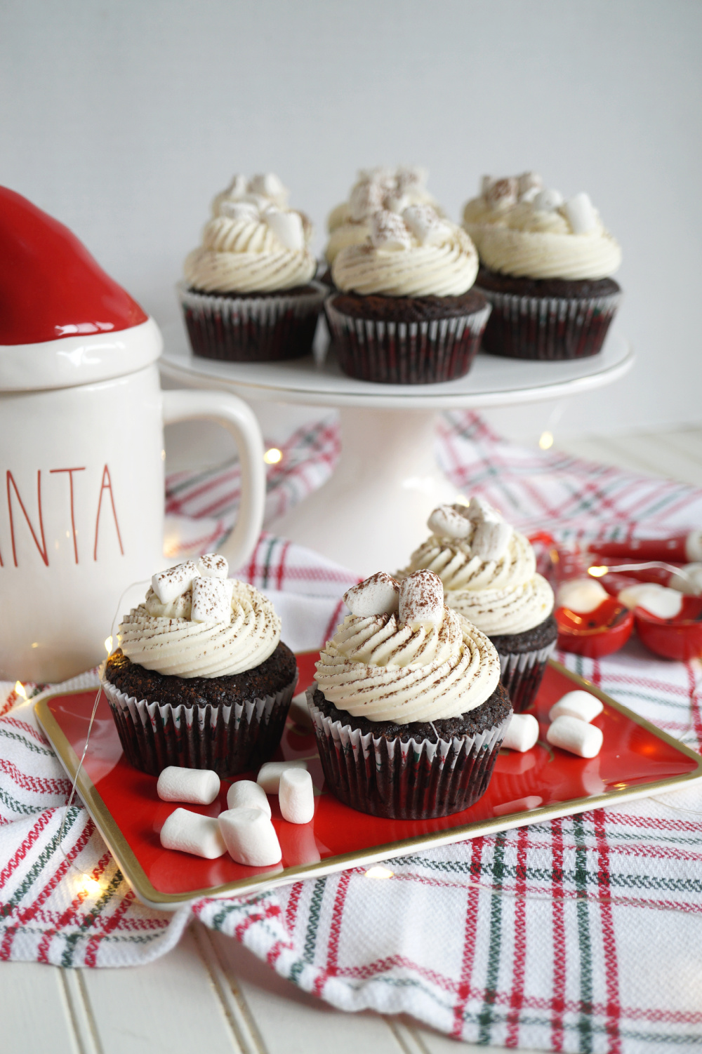 hot cocoa cupcakes on red tray