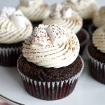 hot cocoa cupcakes on cake stand