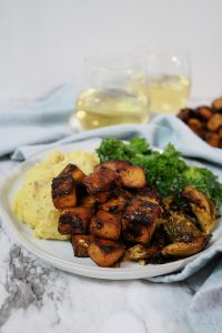 balsamic herb tofu on a plate with mashed potatoes and kale salad