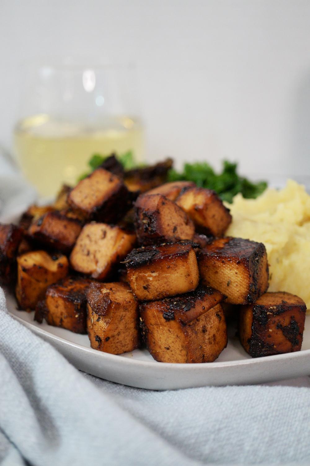 close up of baked balsamic tofu cubes
