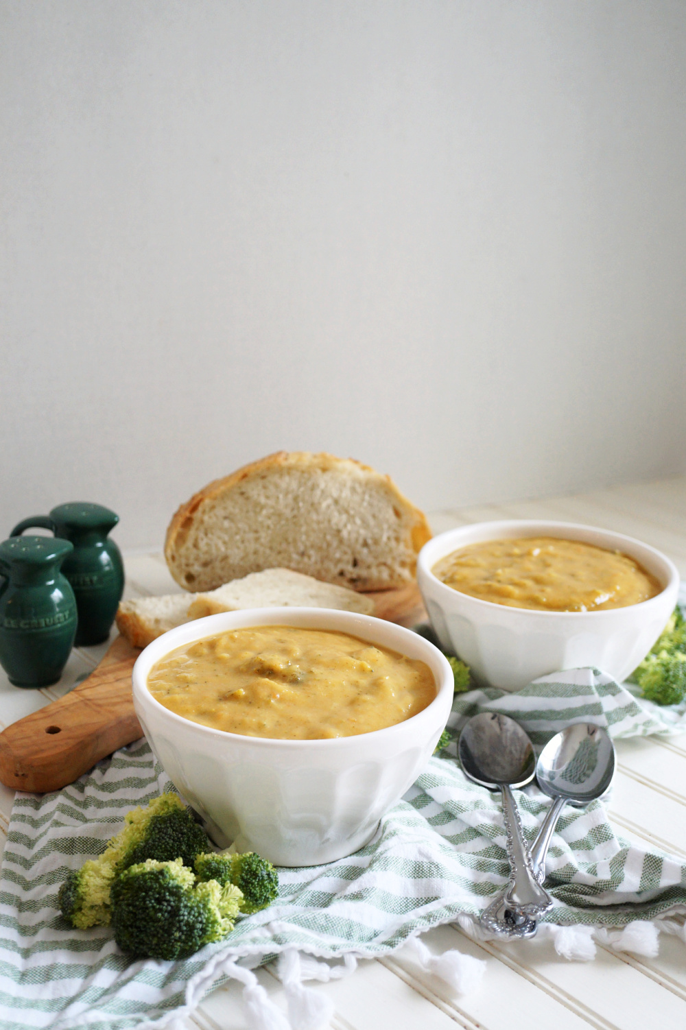 two bowls of broccoli cheese soup