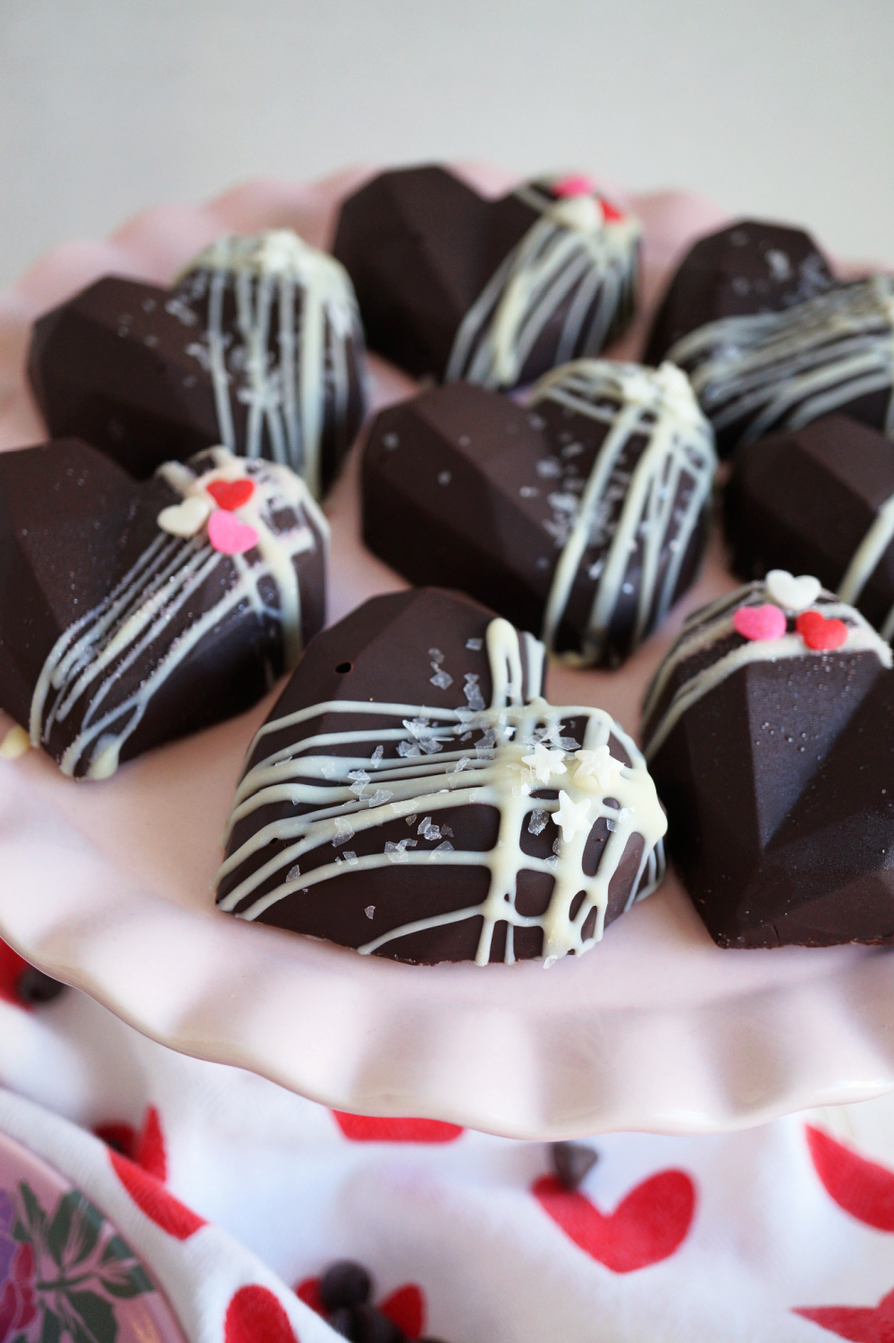 heart shaped chocolates on pink cake stand