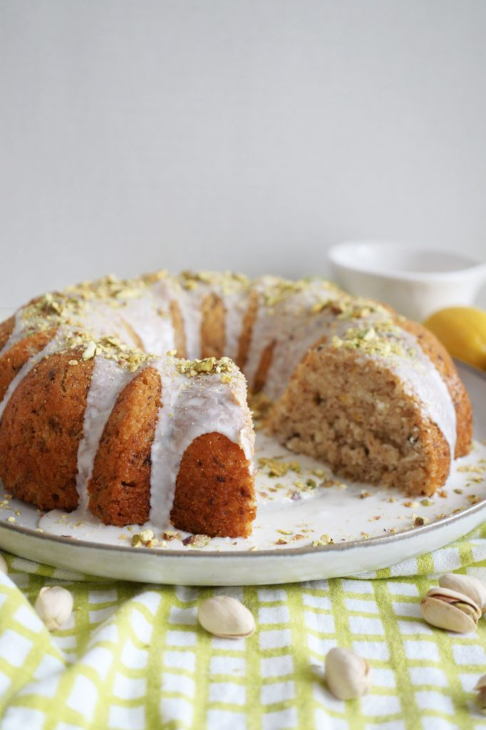 lemon pistachio cake with slice cut out
