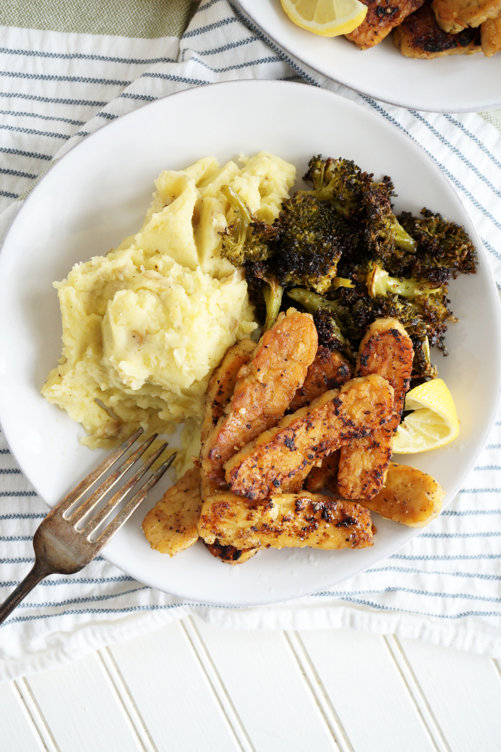 plate of lemon pepper tempeh with side dishes
