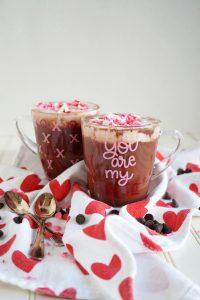 two clear mugs of red velvet cocoa