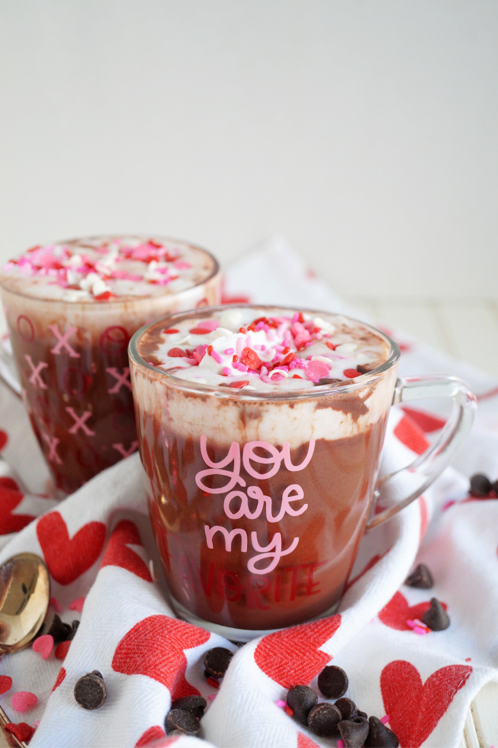 two mugs of red velvet hot cocoa