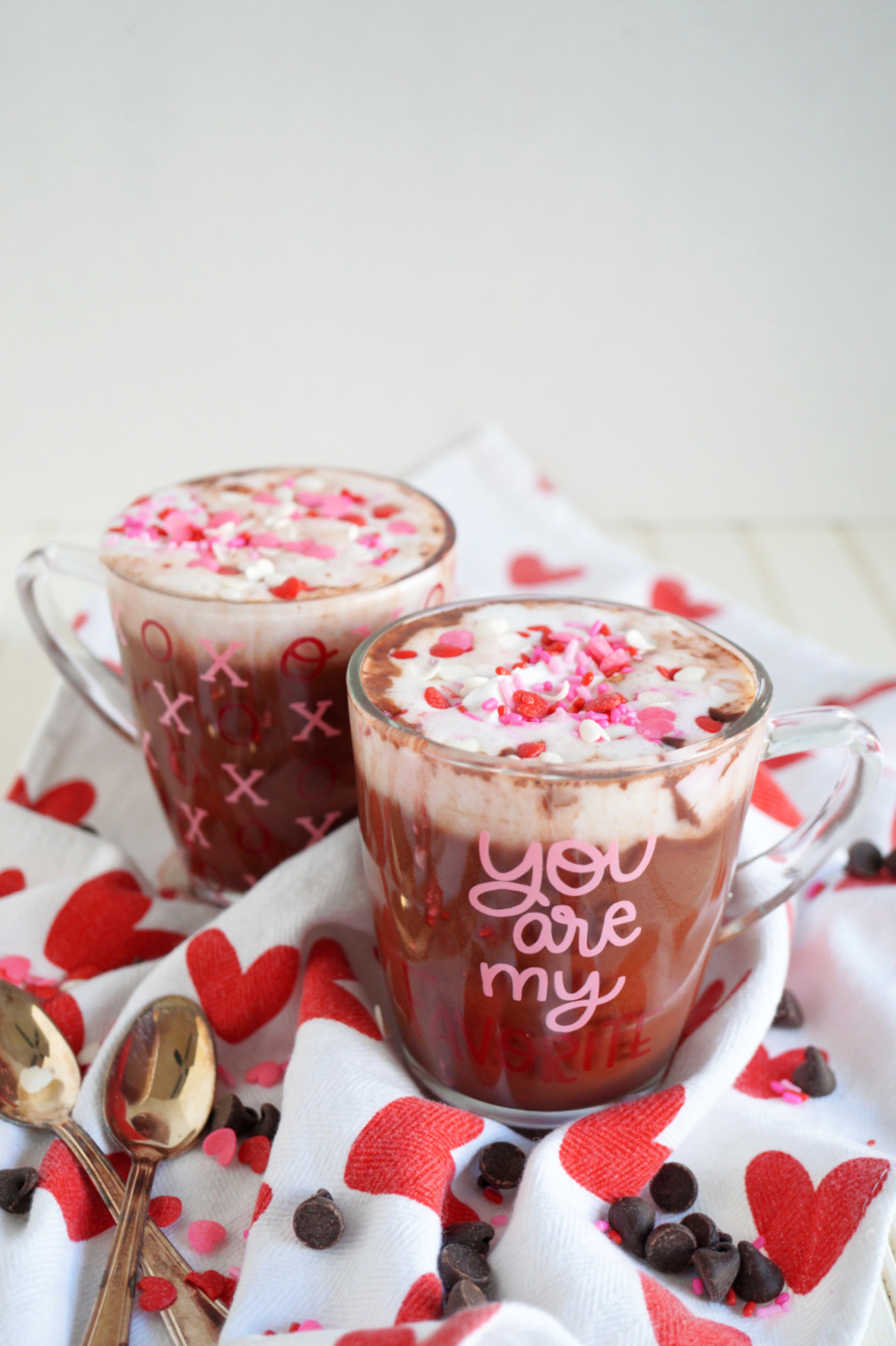 angled glass cups of red velvet hot cocoa