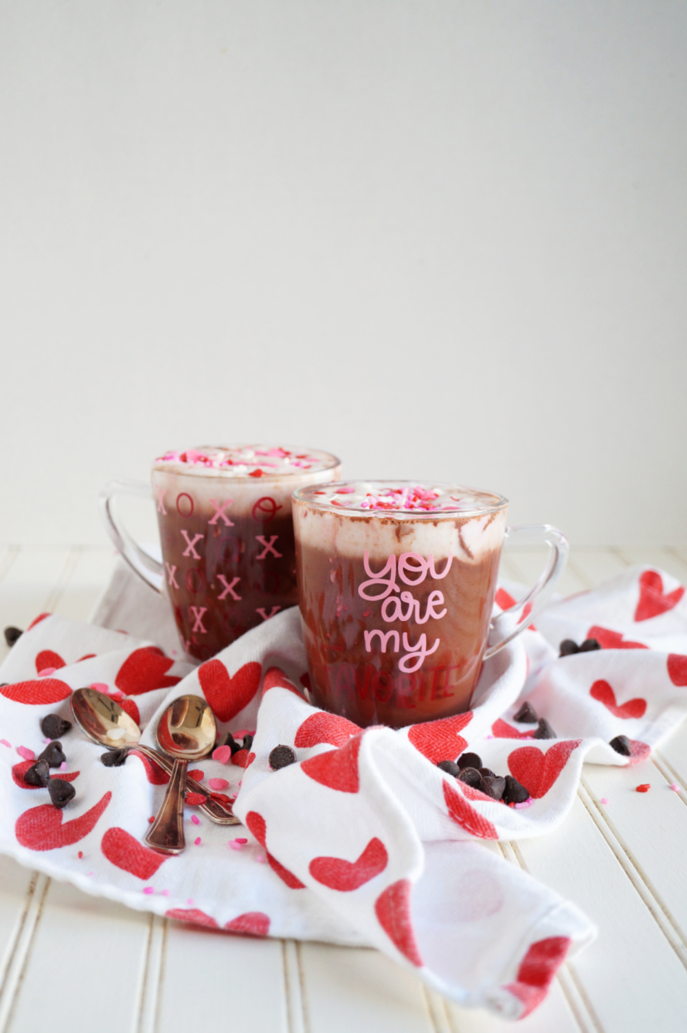 two glass mugs with hot cocoa