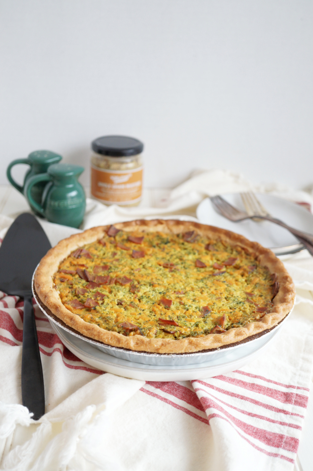 broccoli ham and cheese quiche on platter