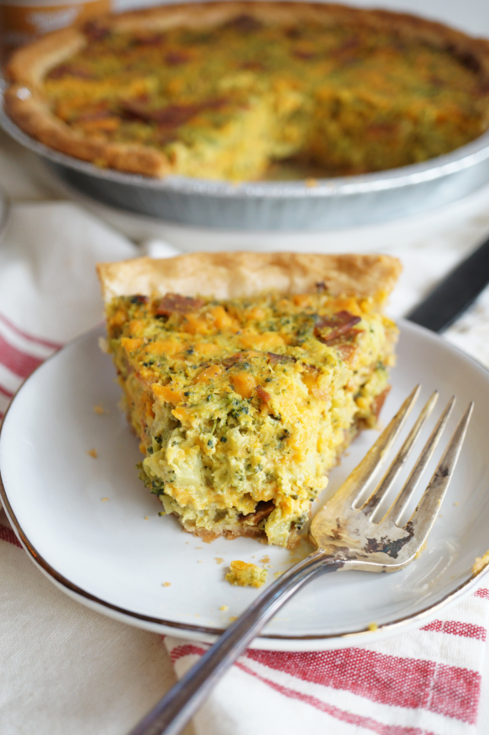 slice of quiche with bite missing