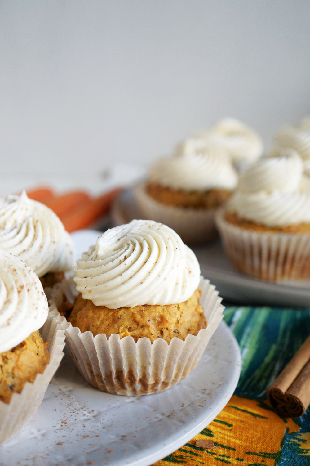 carrot cake cupcakes with swirled white frosting