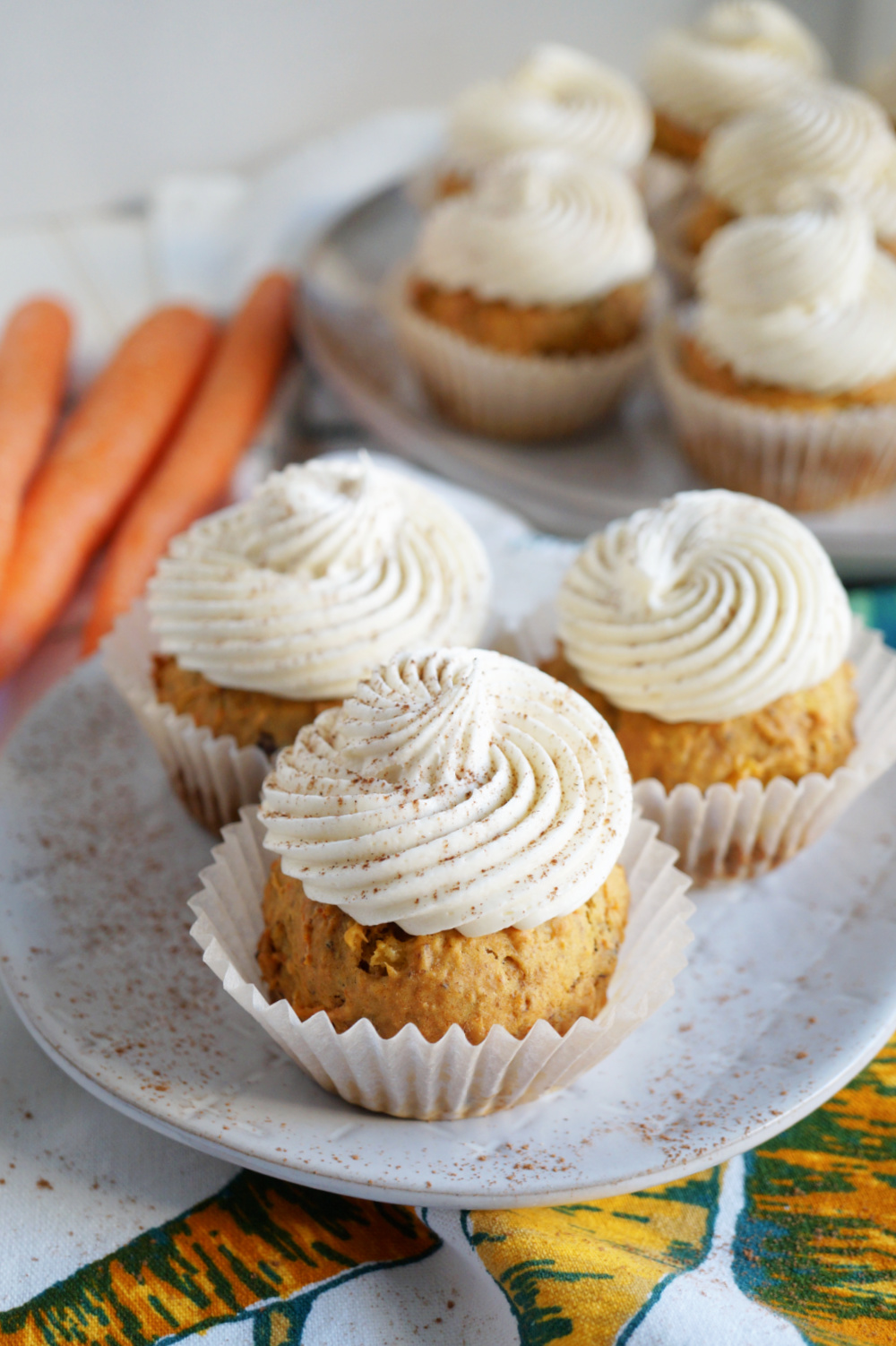 three carrot cupcakes on plate