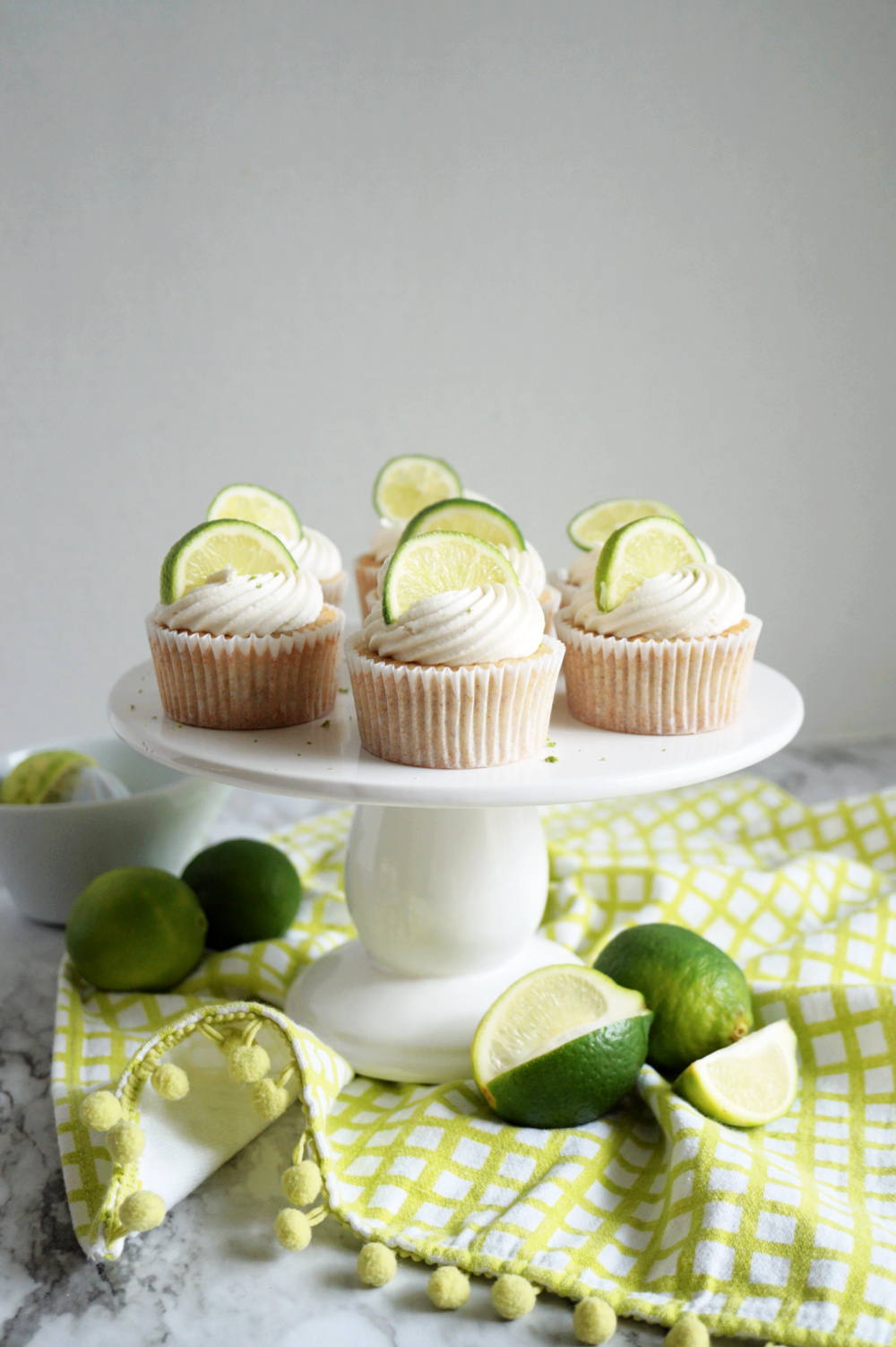 key lime cupcakes on cake stand