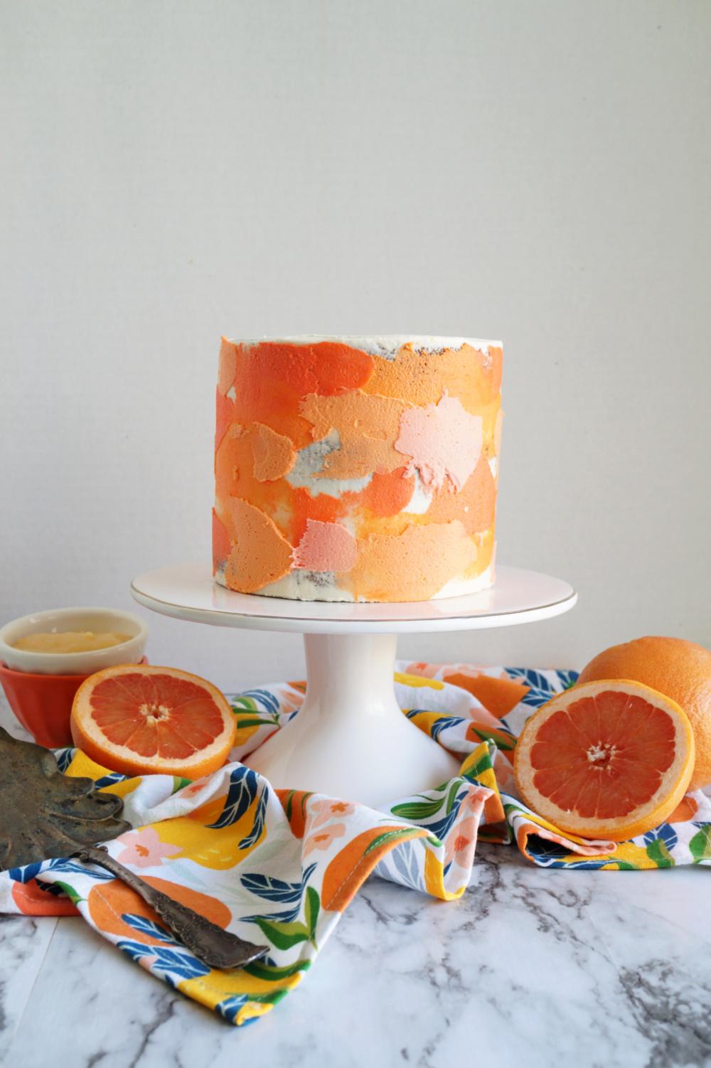 grapefruit poppyseed cake on stand