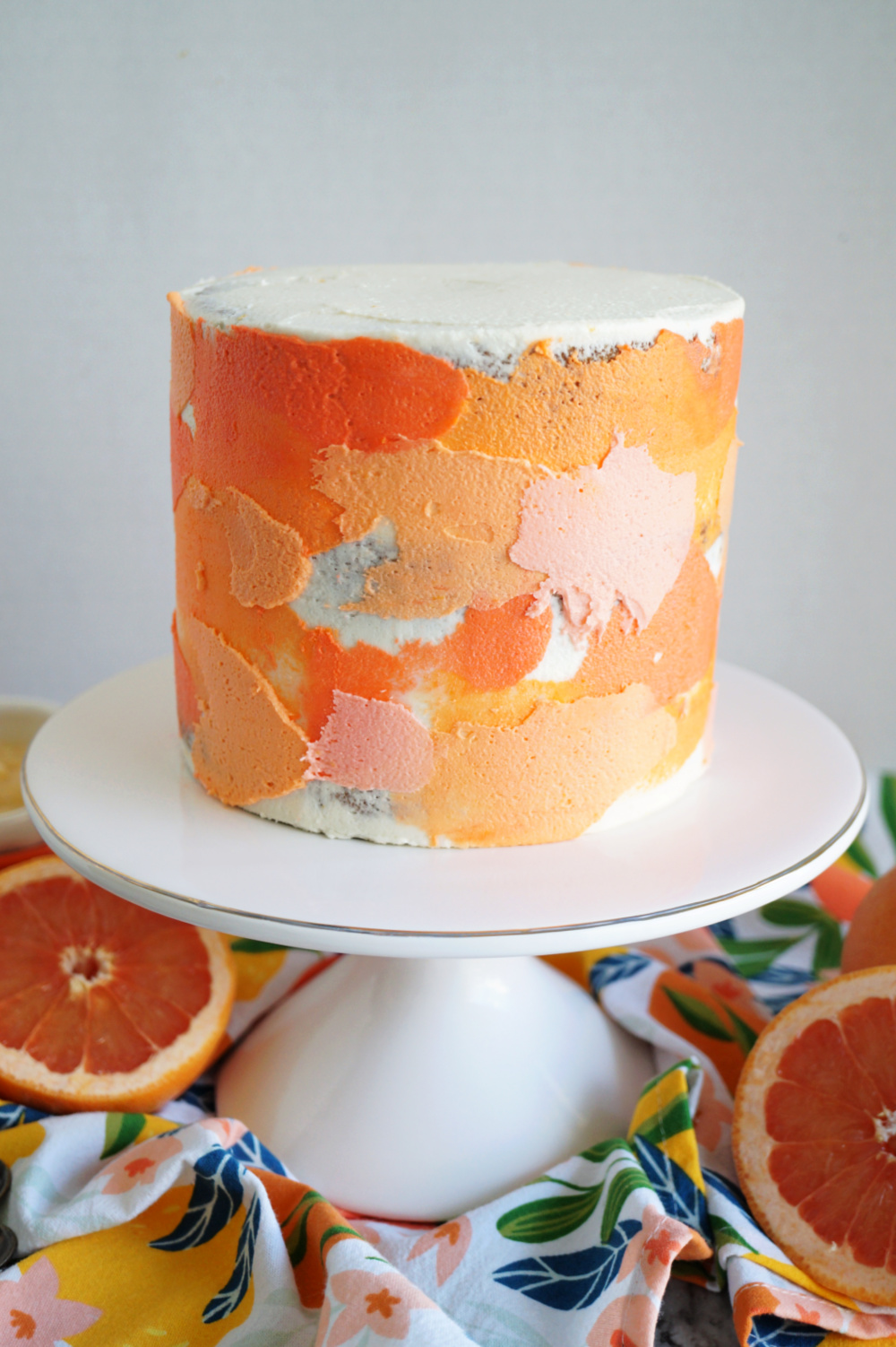 grapefruit cake on stand