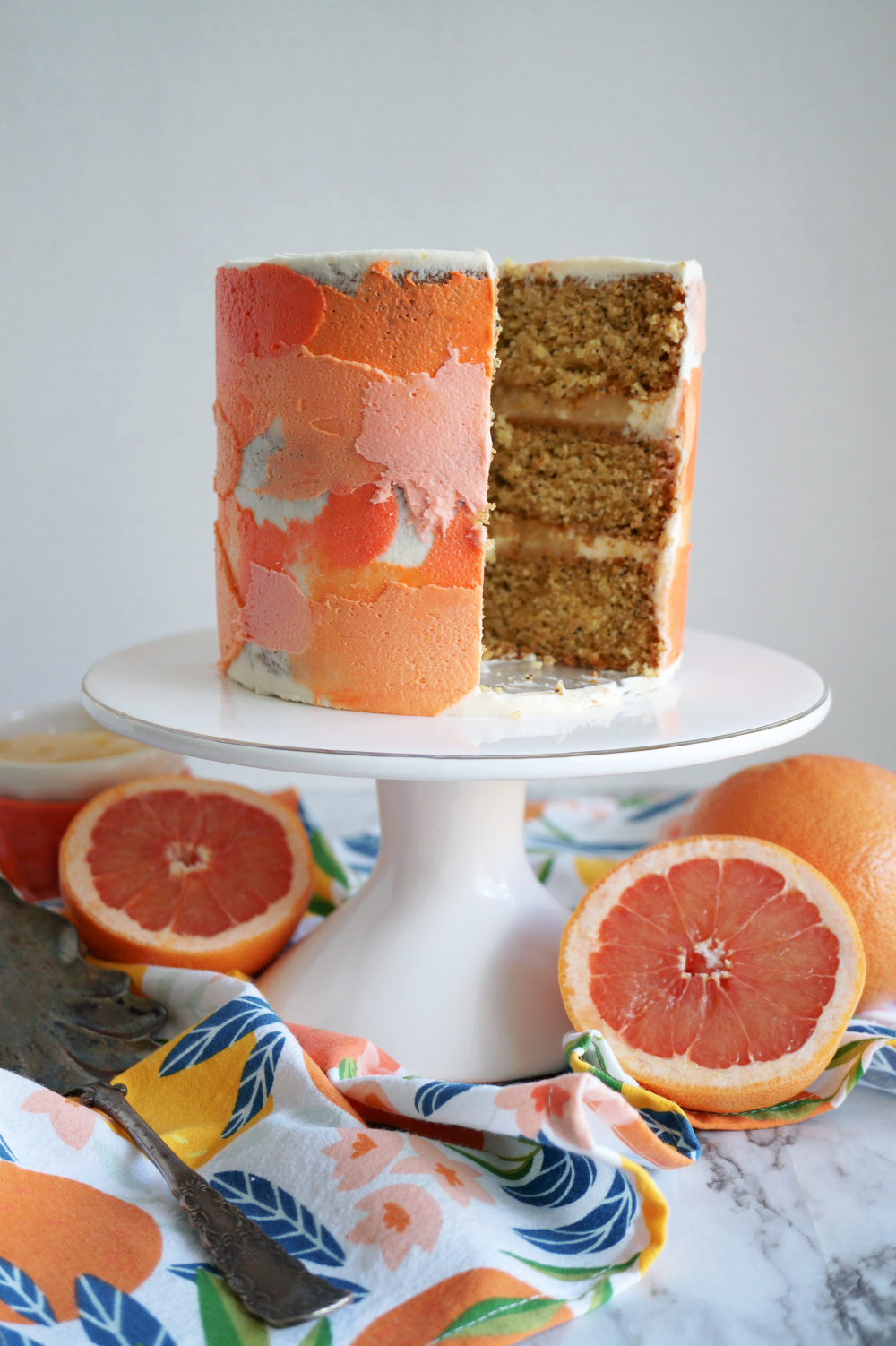 grapefruit cake with slice cut out